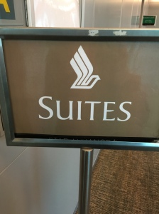 Sign indicating entry for Suites passengers