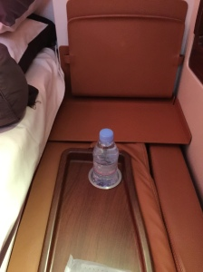 A bottle of Evian by the side