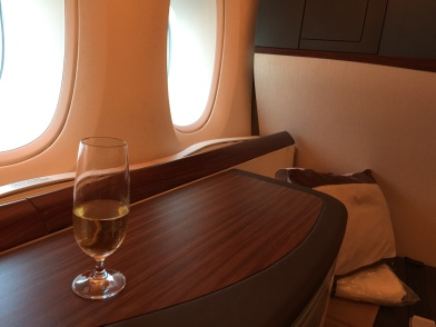 A glass of Dom 04 while admiring the planes from Suites 3A while...