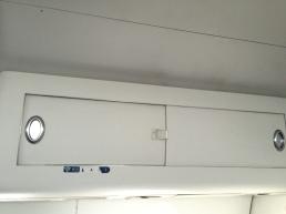 Overhead bin with sliding door