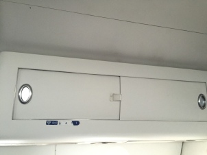 Overhead bin with sliding door