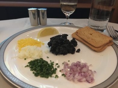 Lemon, Melba toast, Chopped onions, spring onion, egg white and yolk and finally the Caviar
