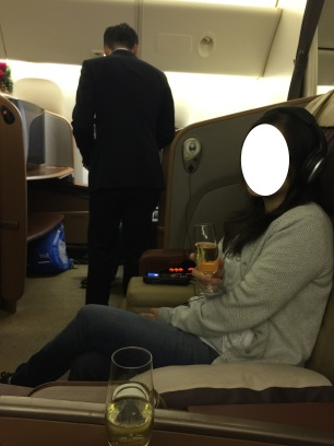 Sipping some bubbly while waiting for our turn to take off