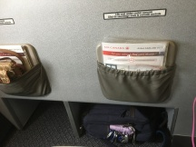 Storage area in front of seats 2A/2C